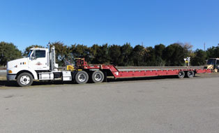 lowboy tractor trailer for track maintenance